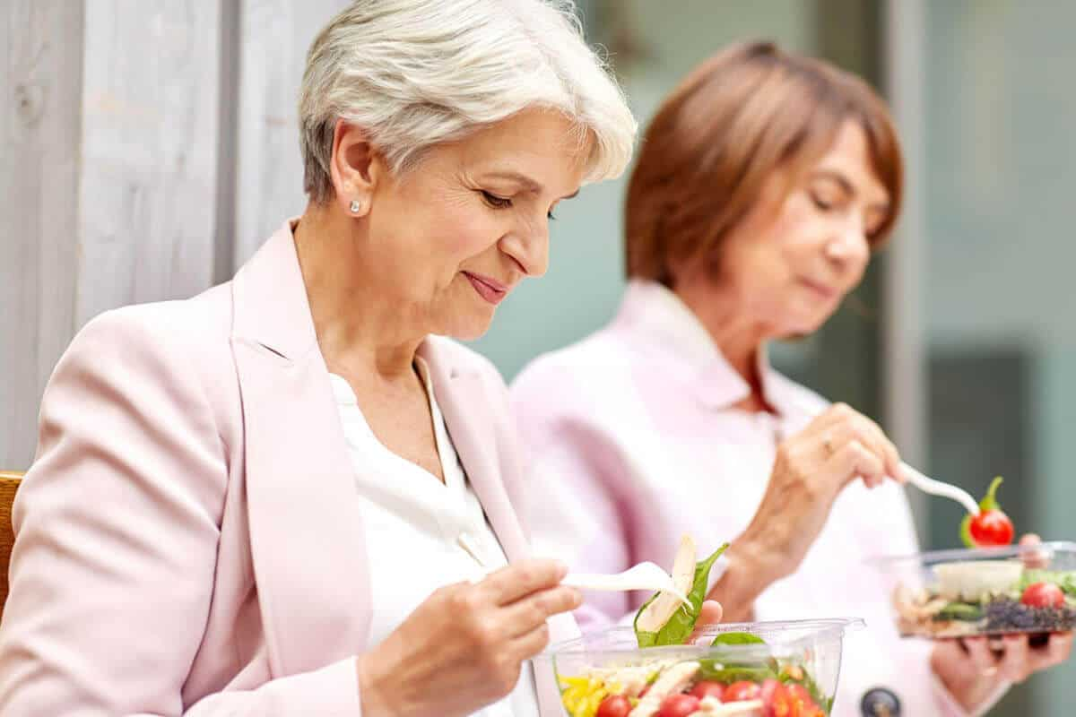Older women eating salads
