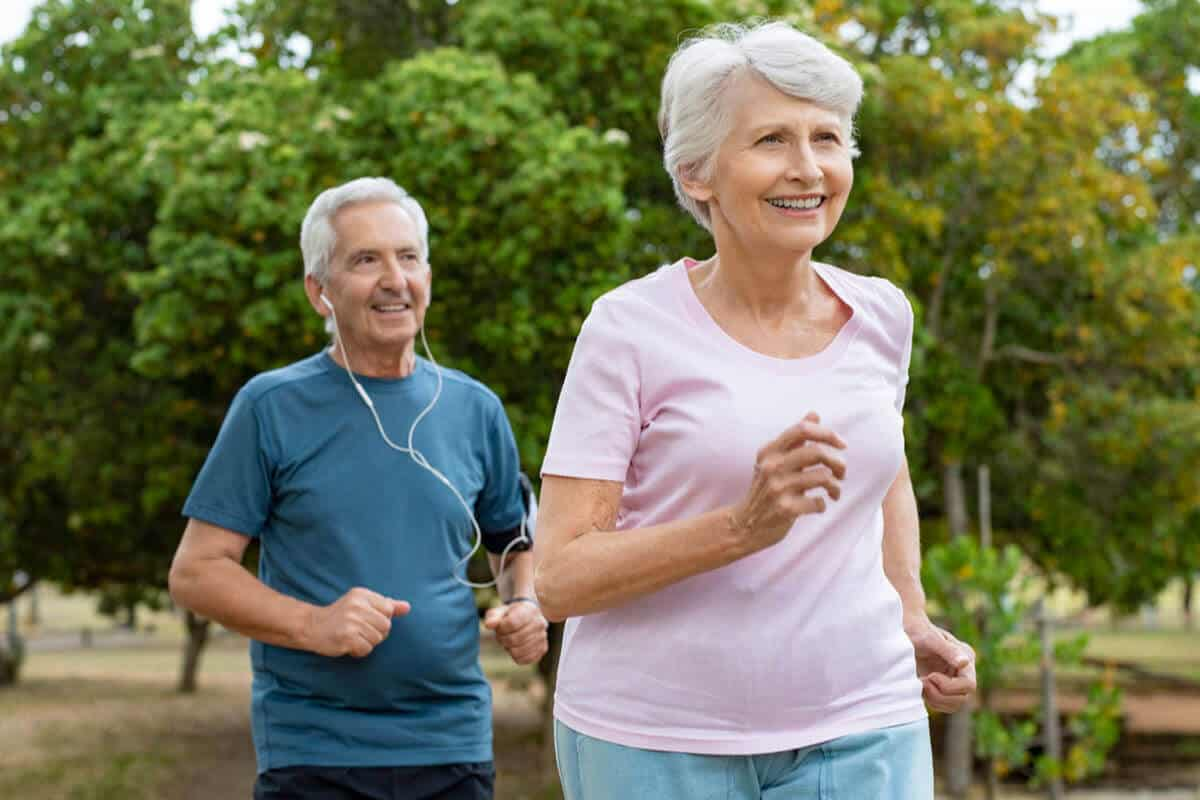two elderly running outside