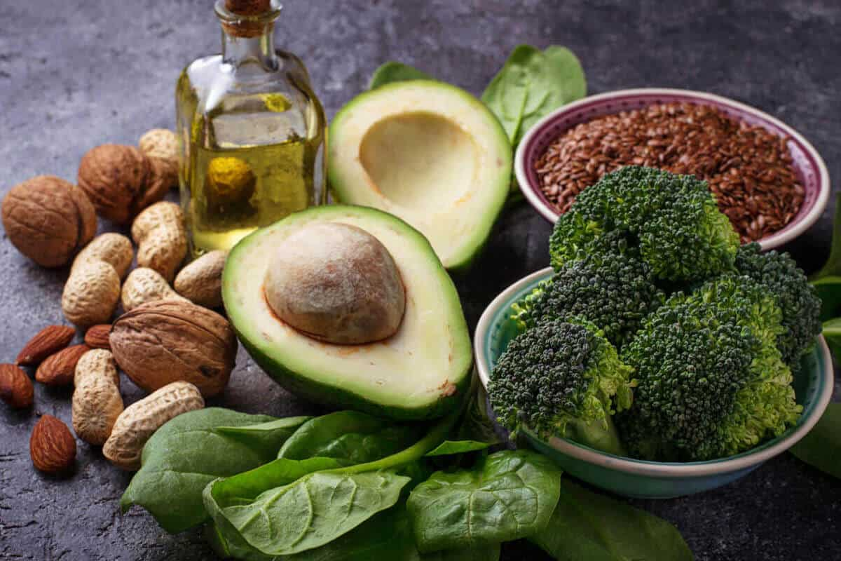 variety of nuts, flaxseeds, avocado and avocado oil, broccoli, and spinach