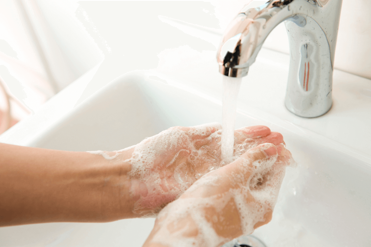close up of person washing their hands