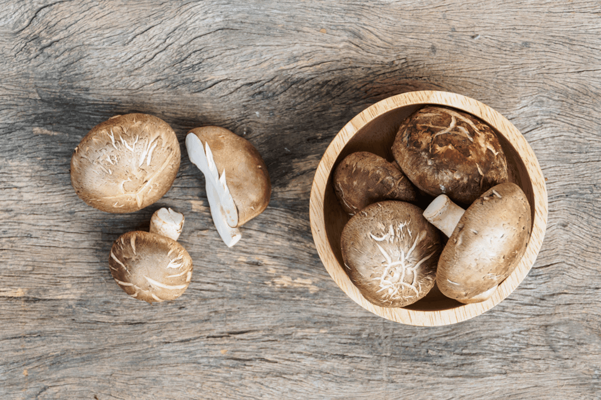 mushrooms in a bowl and on a table