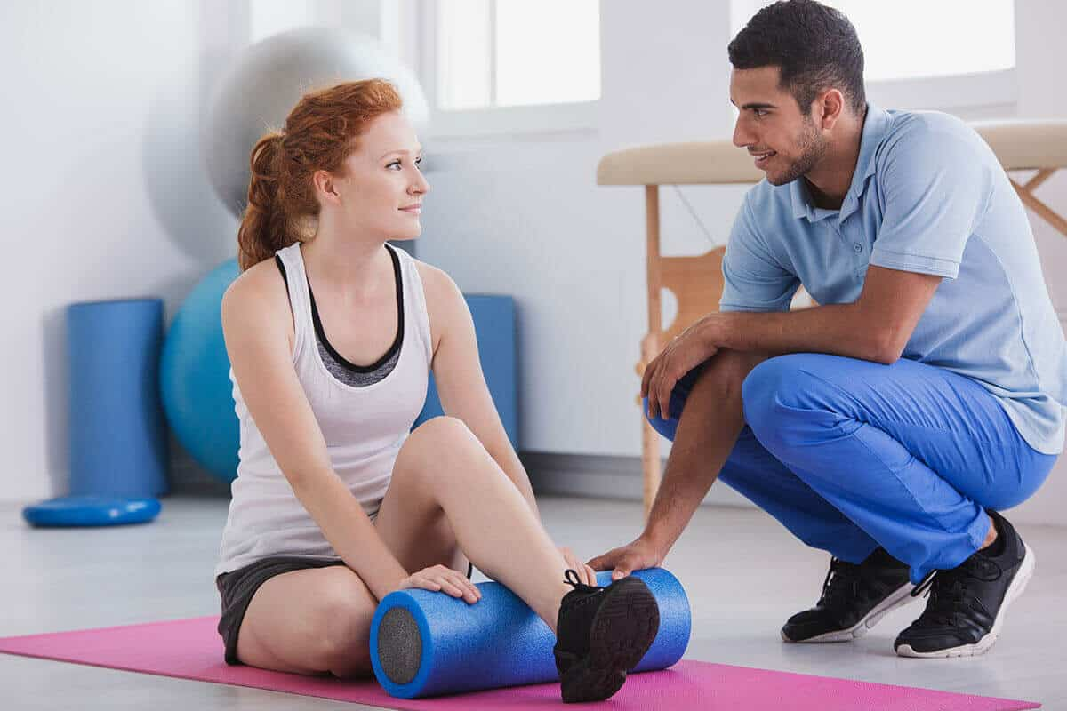 patient with physical therapist working on exercises