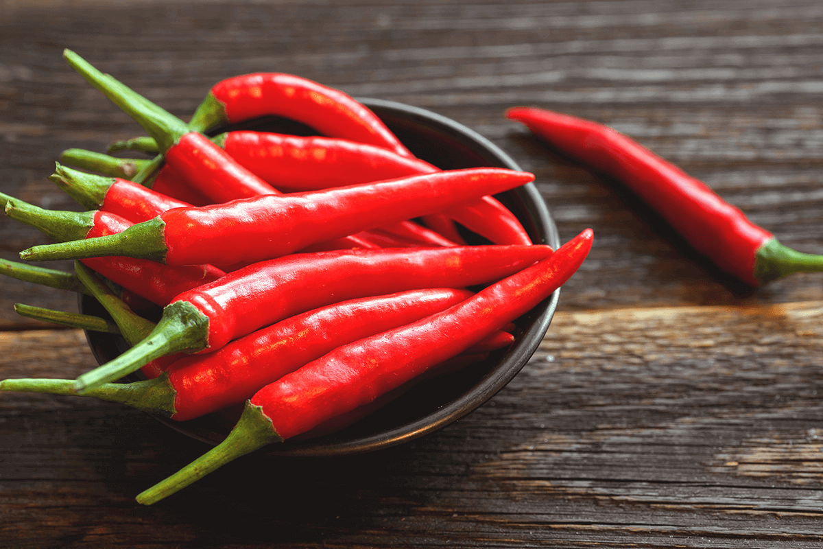 hot peppers in a bowl on a table