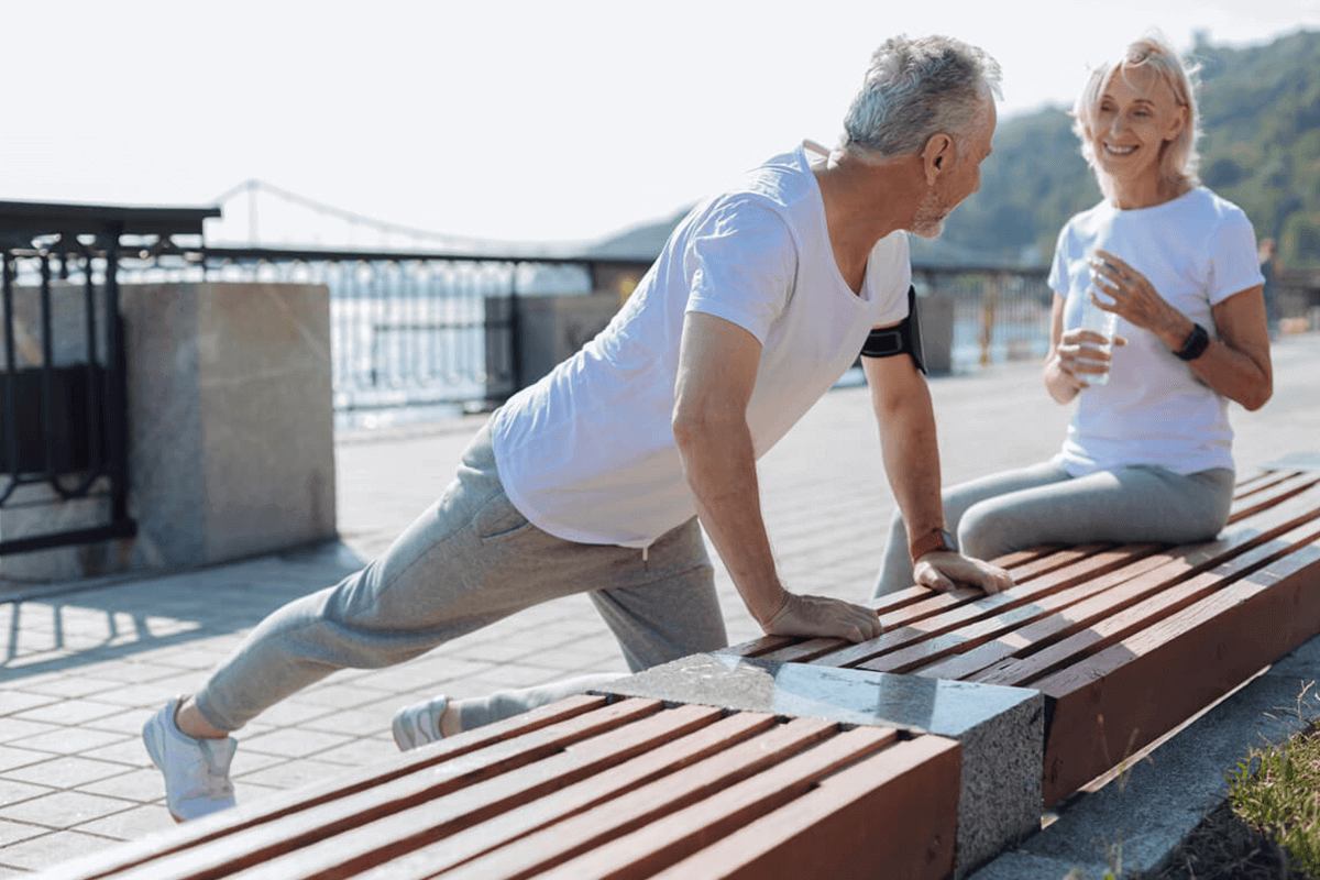 elder couple working out outdoors
