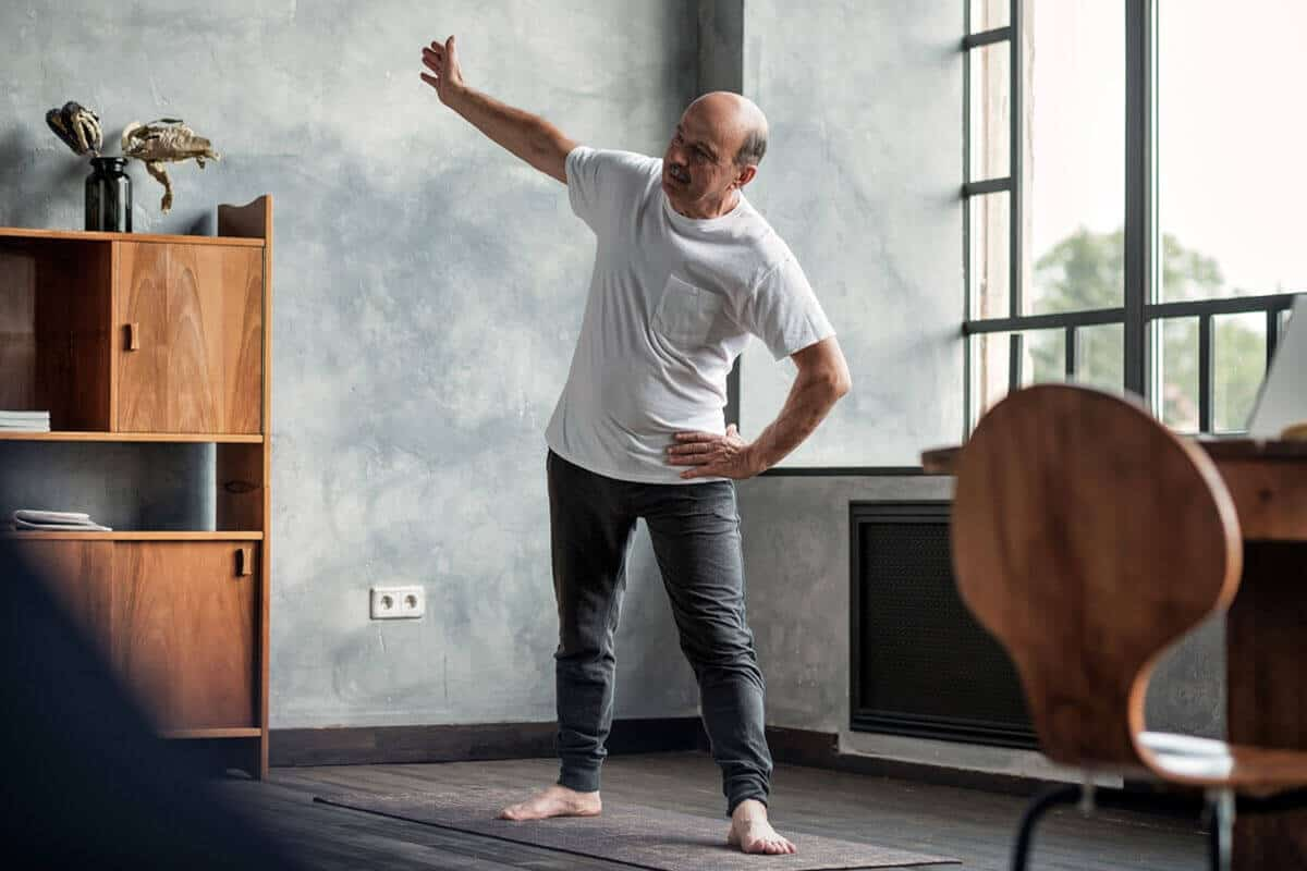 man stretching in his living room
