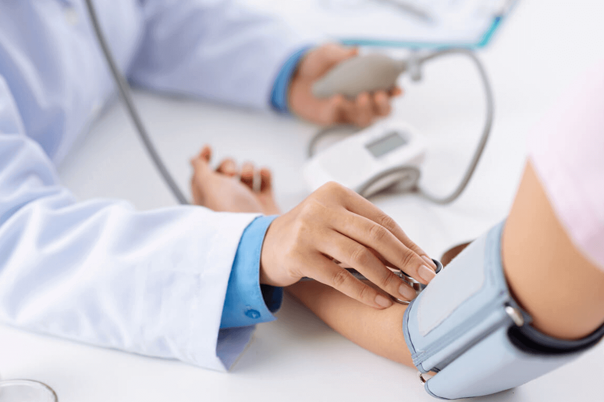 close up of practitioner measuring a patient's blood pressure