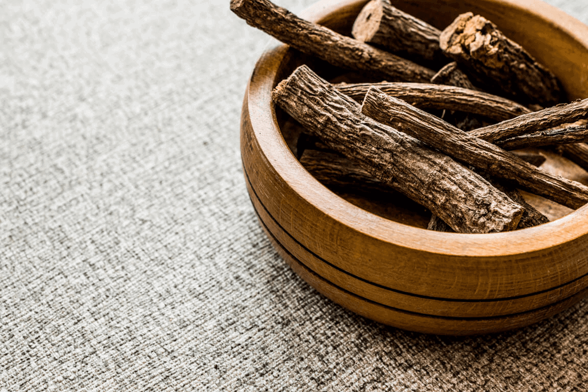 licorice root in a wooden bowl