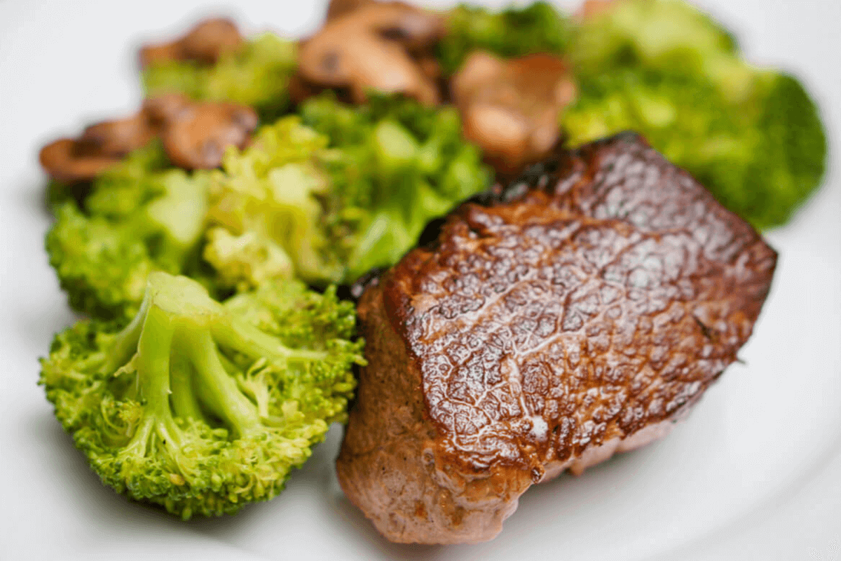 steak dish with broccoli as sides