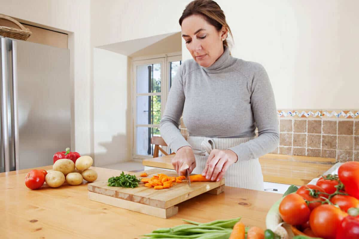 woman in her kitchen putting up vegetables