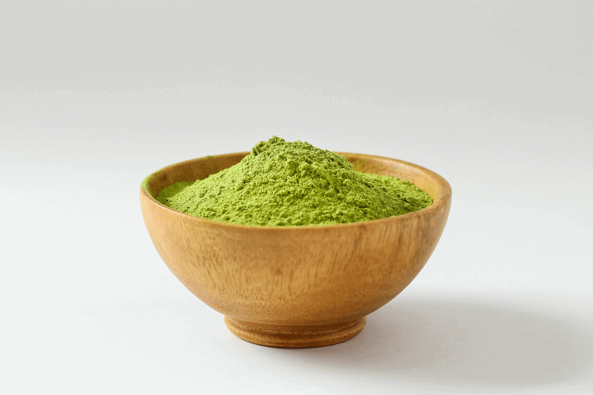 green tea extract in a wooden bowl