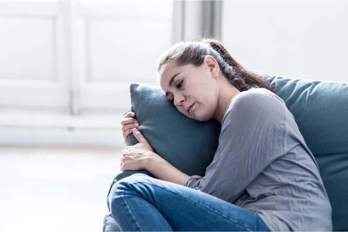 Image of woman laying her head on a pillow