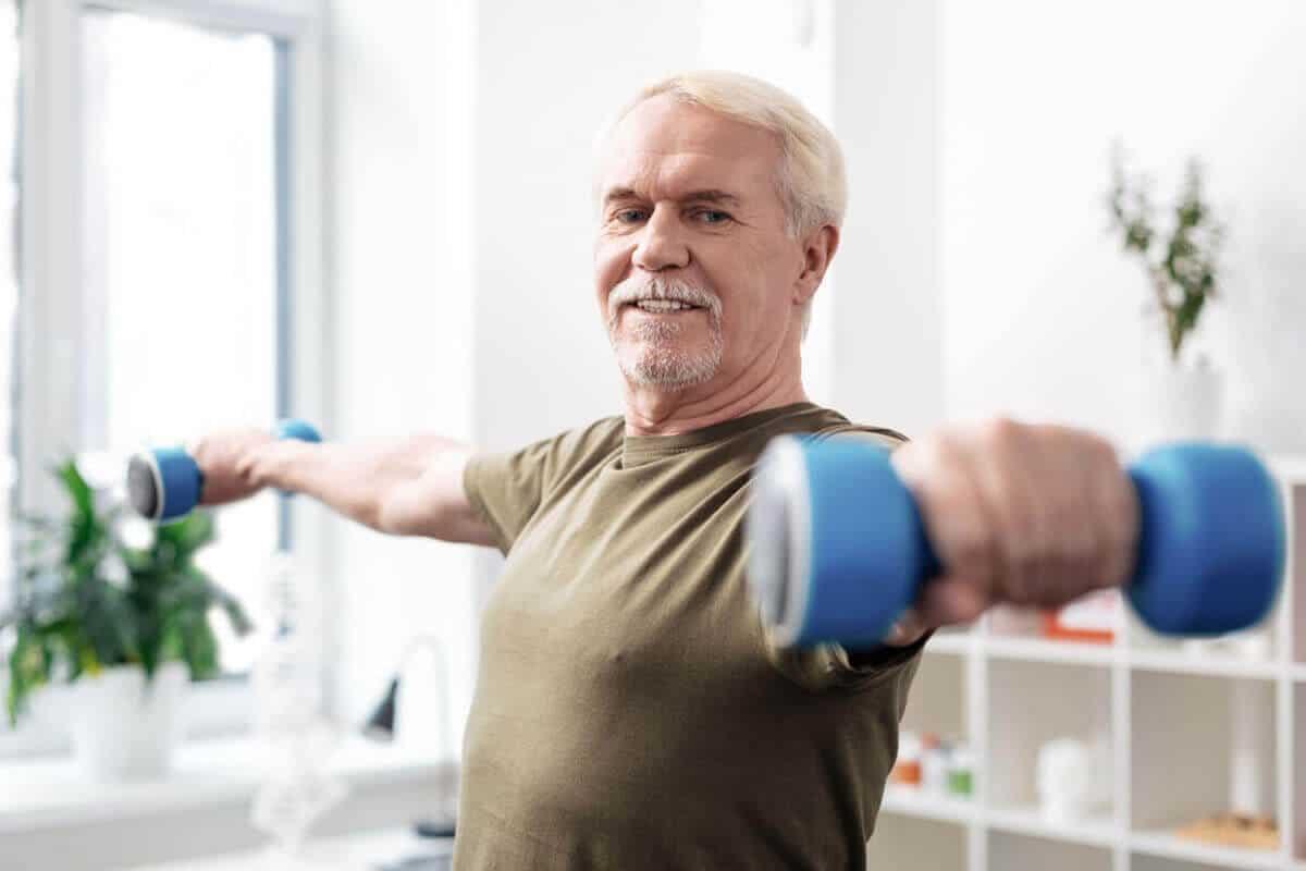 elder man lighting weights in each hand