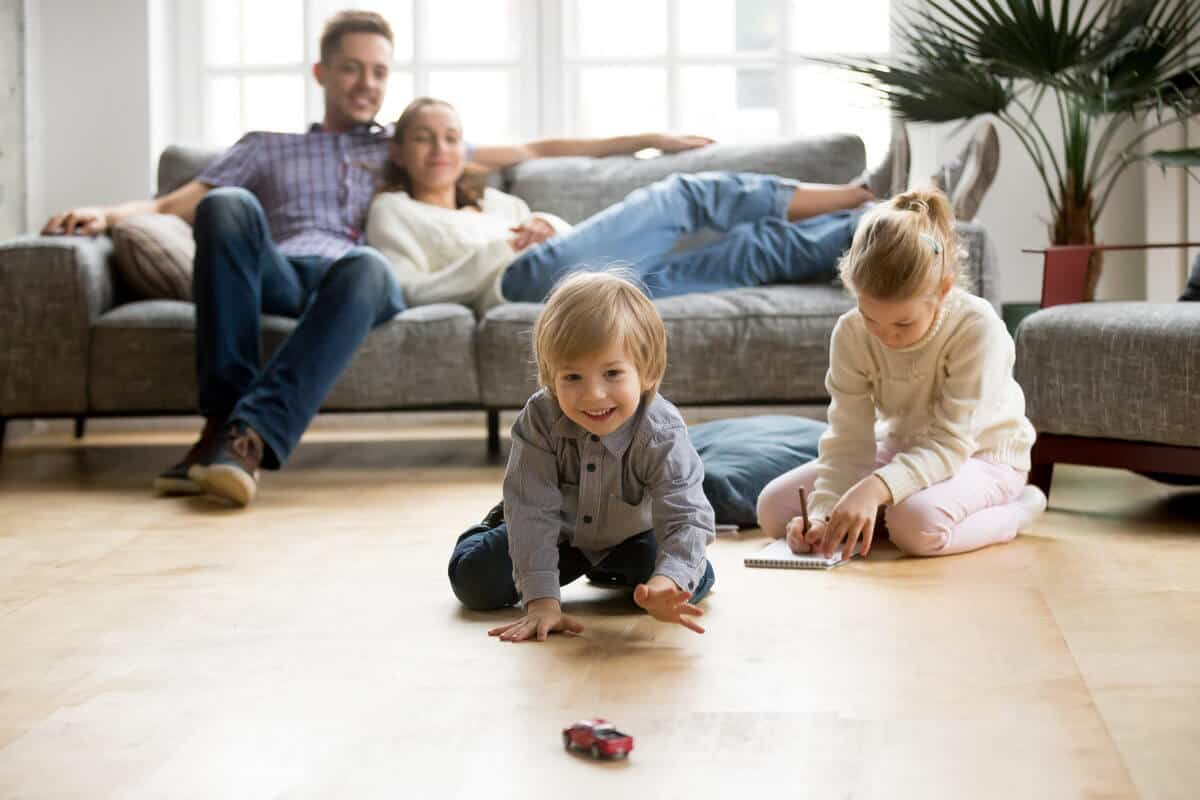 family all together playing in living room