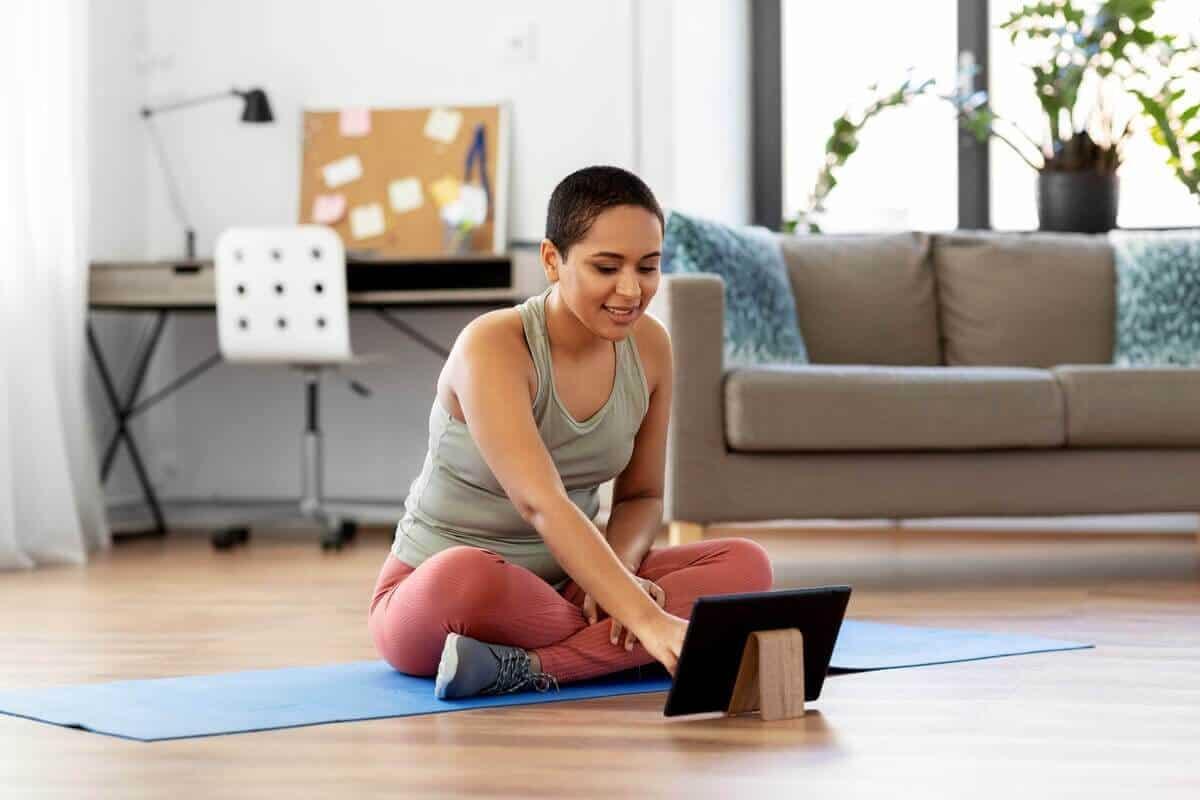 Lady Sitting on Yoga Mat