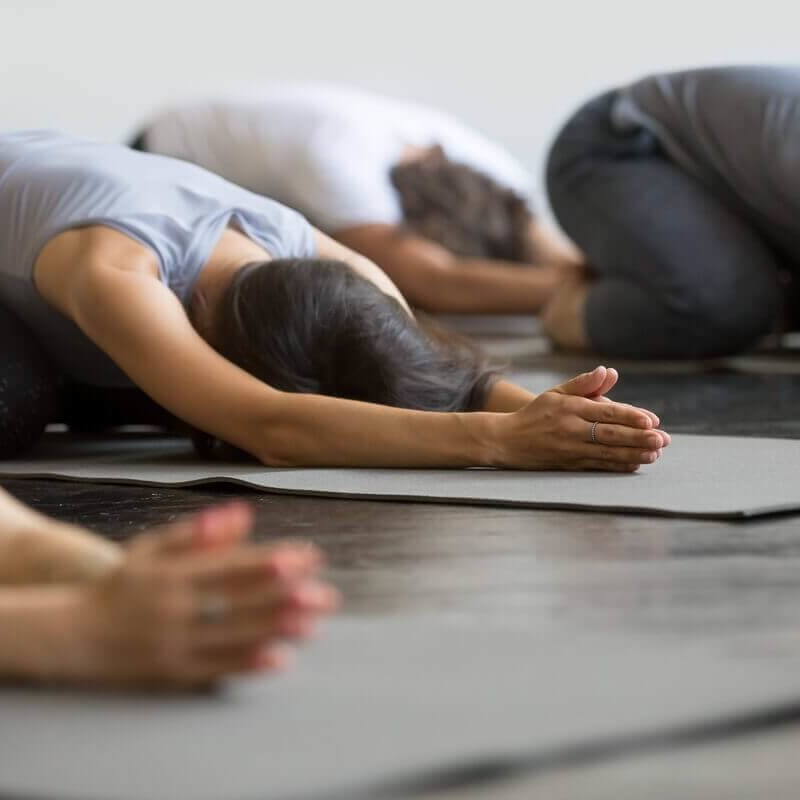 Image of people doing yoga
