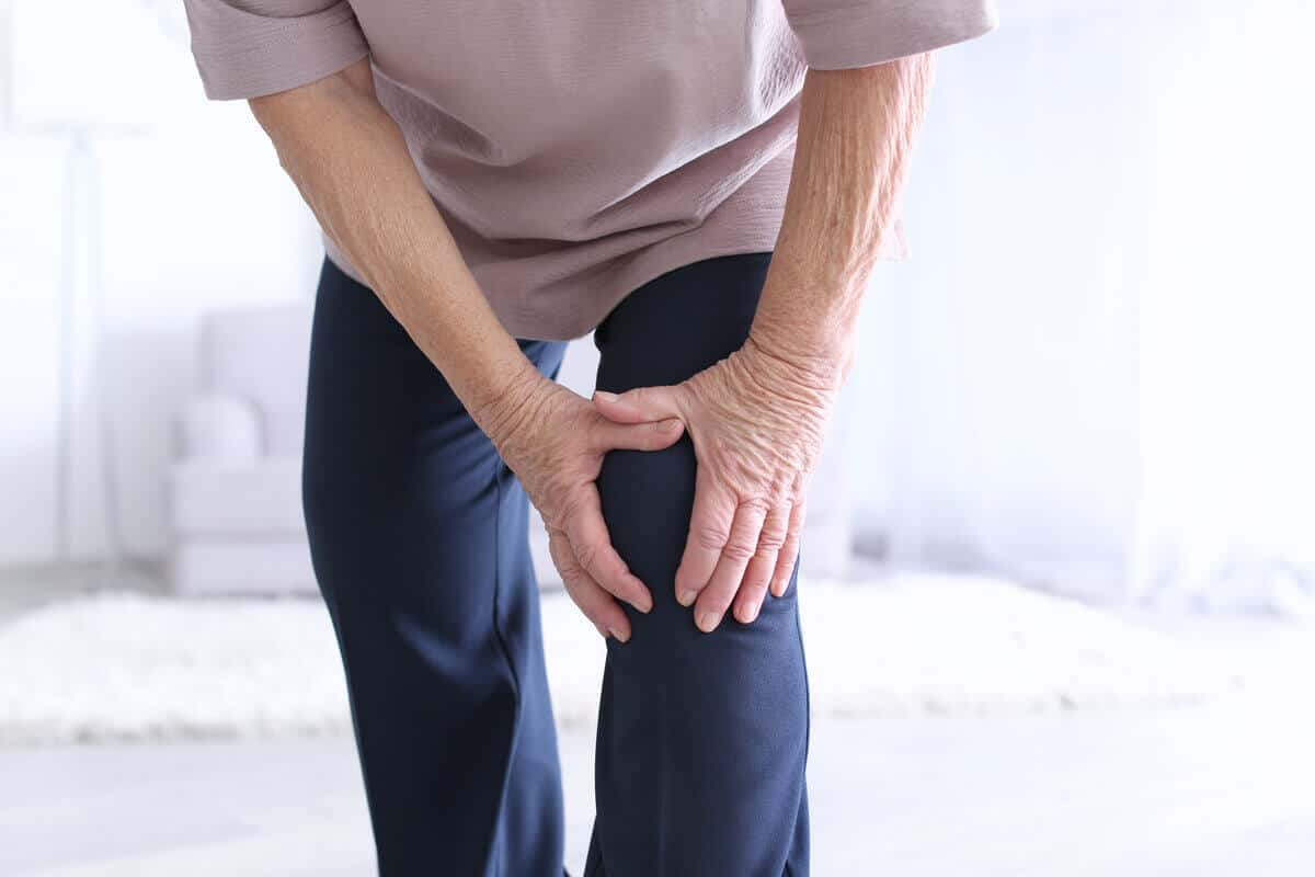 close up of person holding their left knee