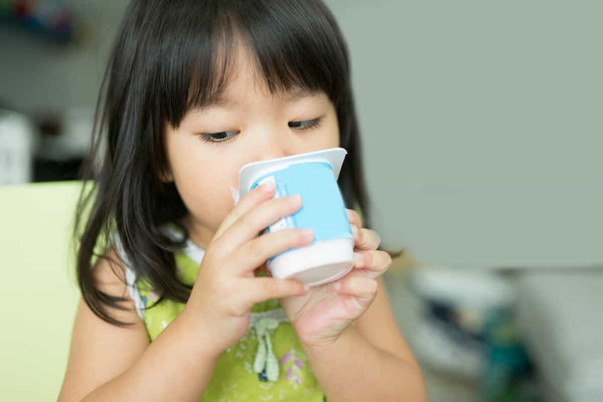 Image of child eating yogurt