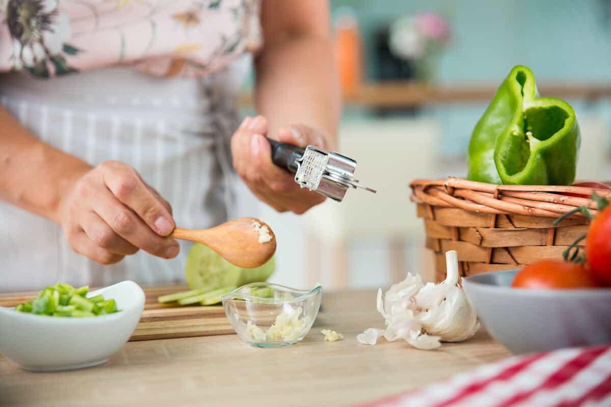 Image of woman crushing garlic