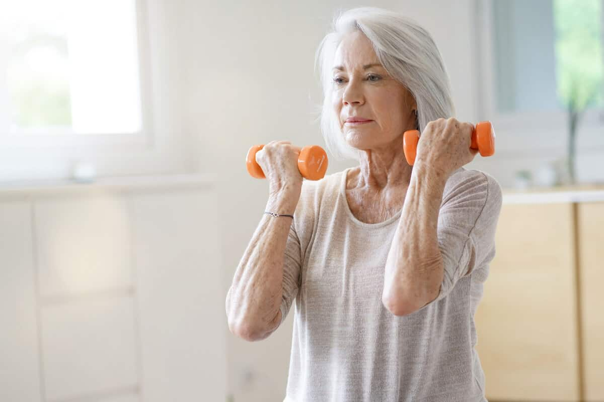 Image of elderly woman lifting weights