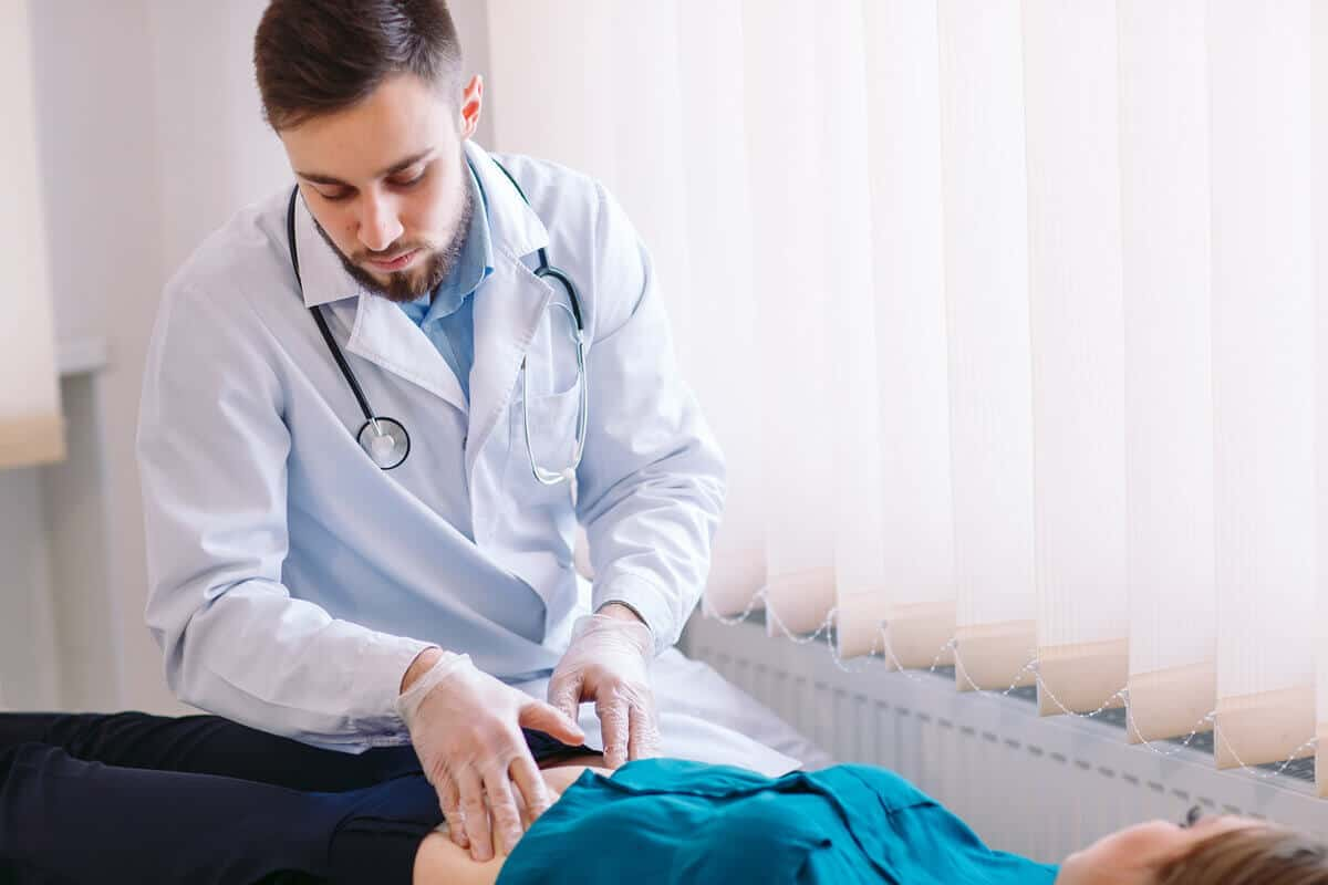 Image of doctor massaging patient