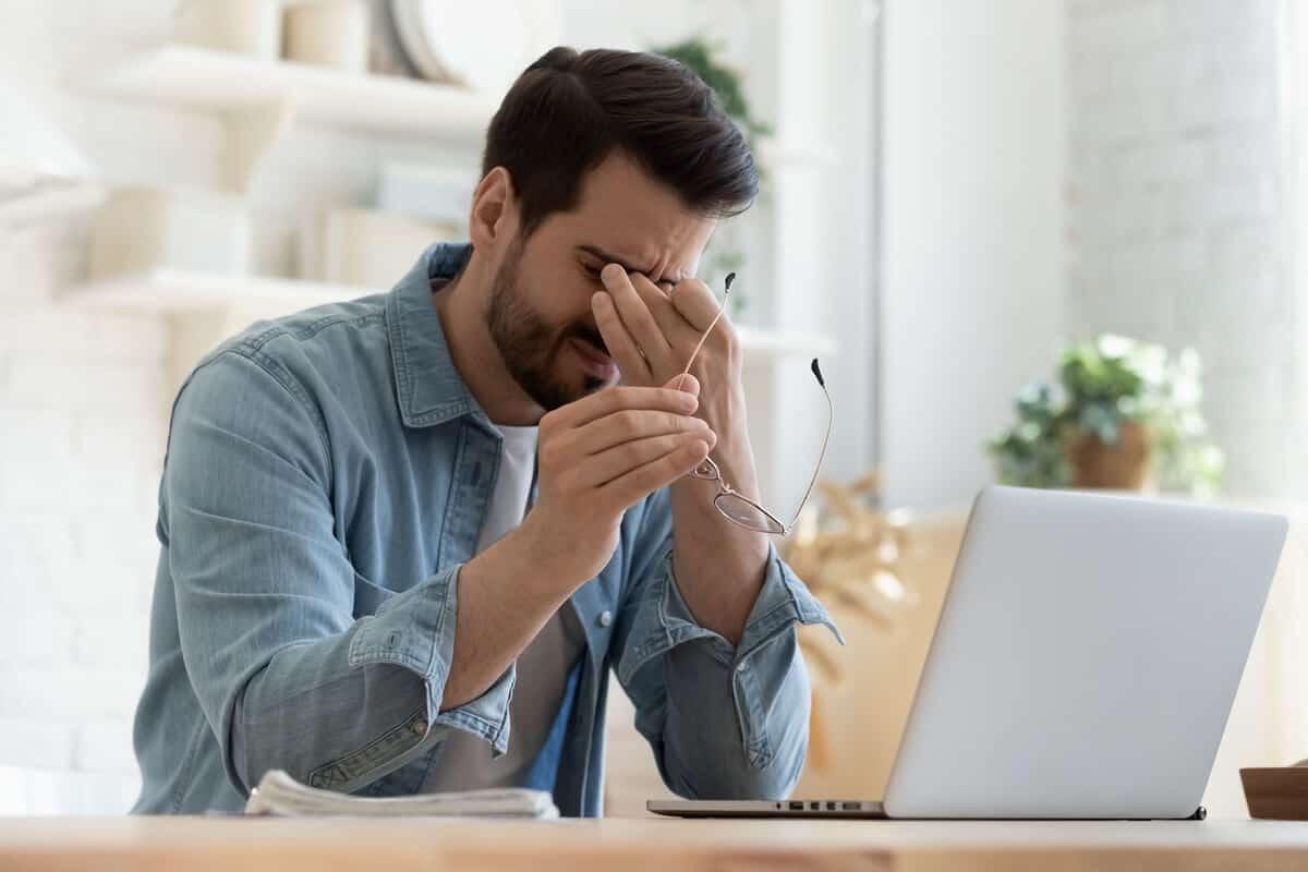 Image of man rubbing his eyes