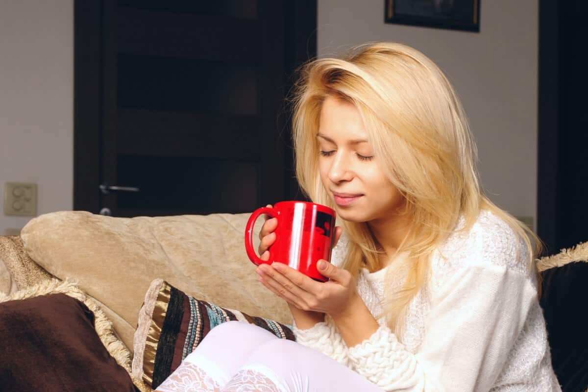 Image of woman holding coffee cup