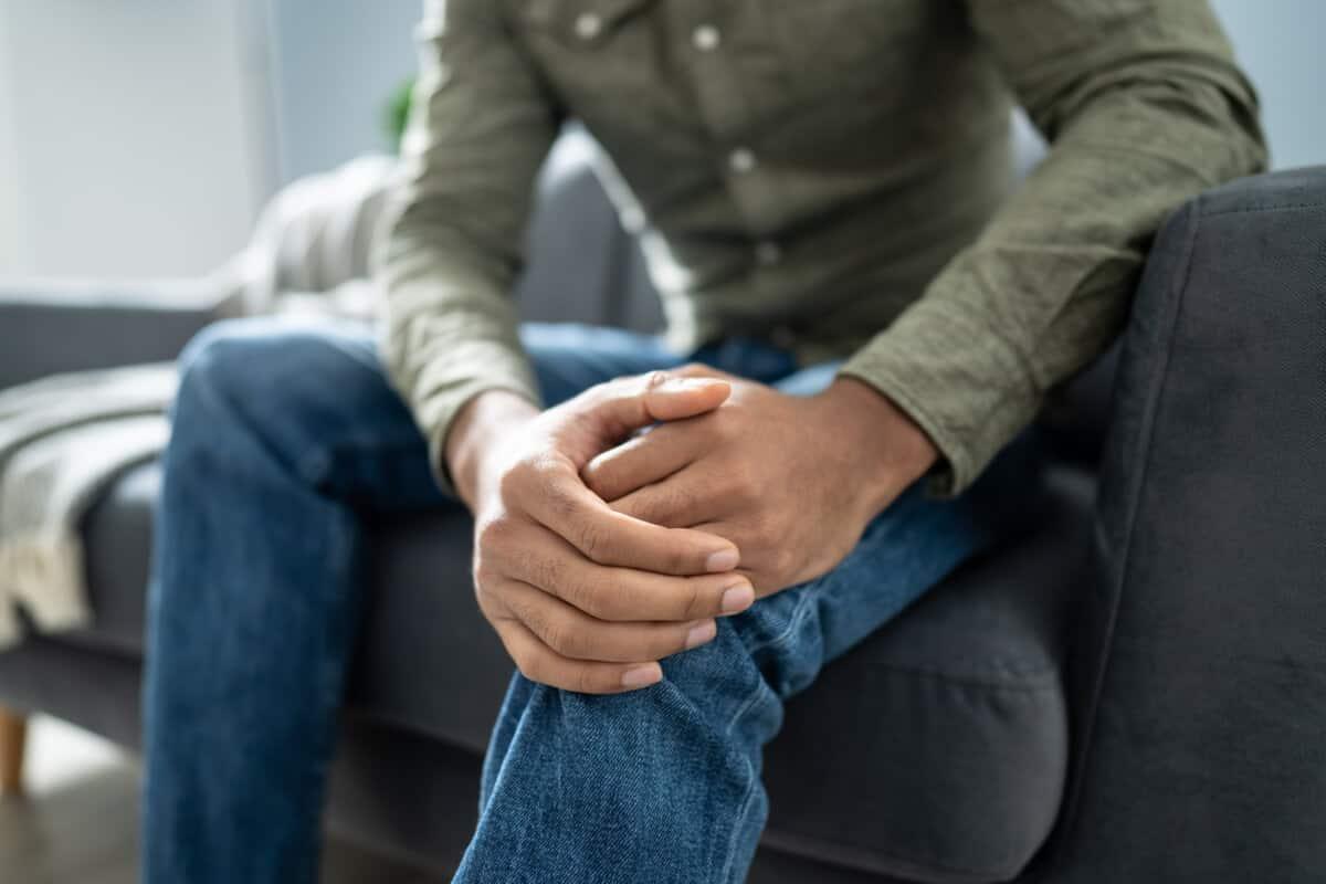 Image of man holding knee