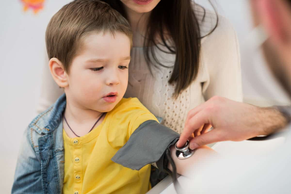 Child getting his heartbeat taken