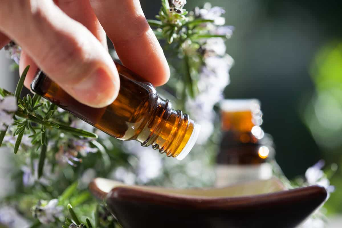 Hand holding a essential oil bottle