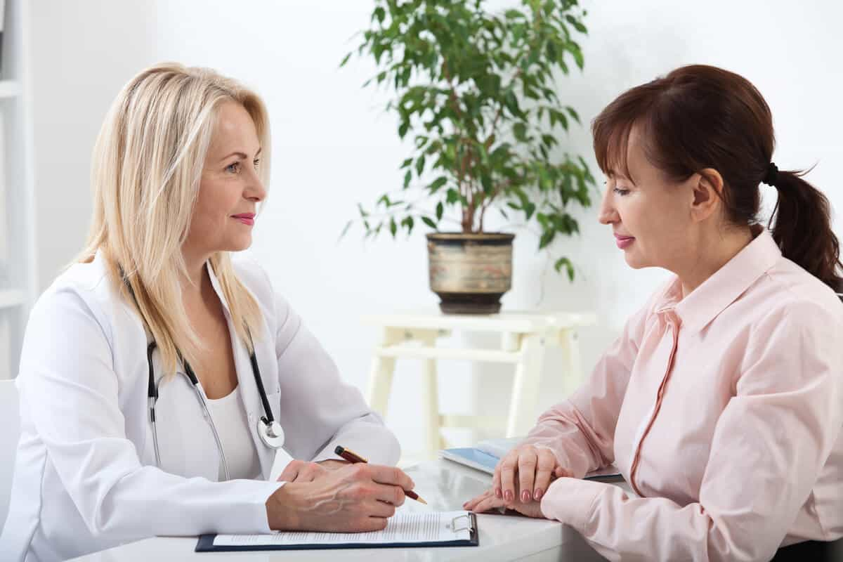 Image of woman consulting doctor