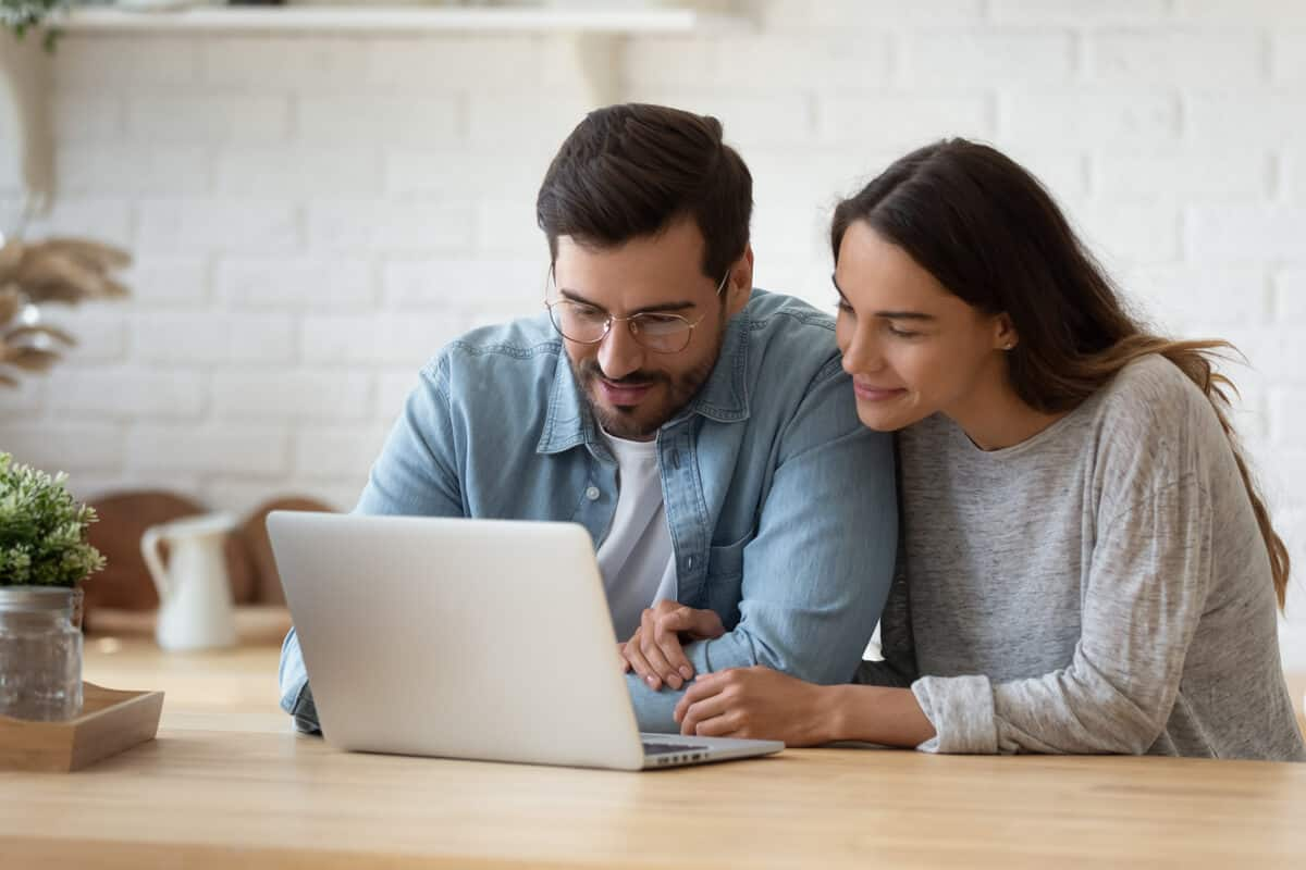 Man and woman looking at a laptop screen