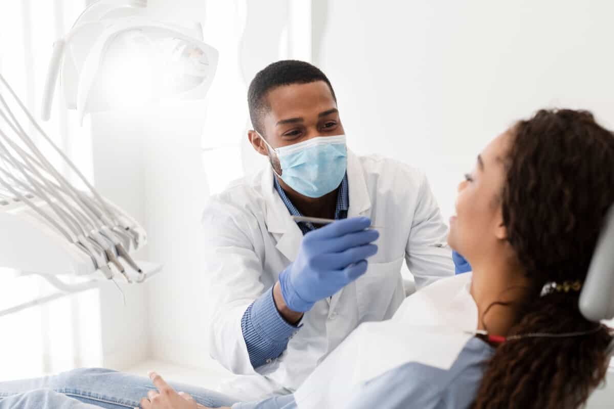 Dentist inspecting a patients teeth