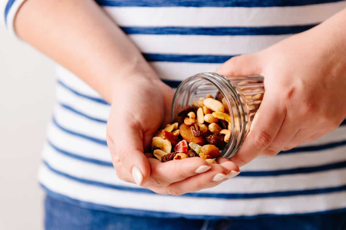 Woman pouring nuts into her hand