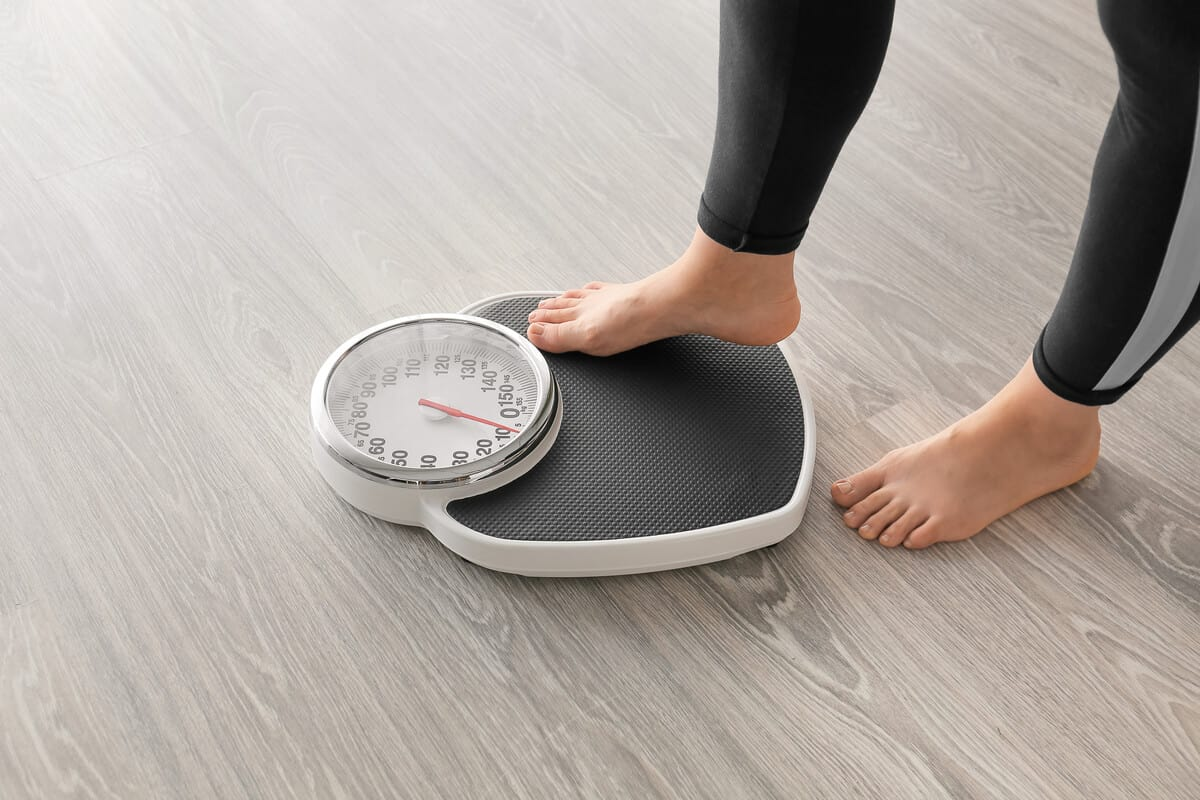 Person stepping on a scale