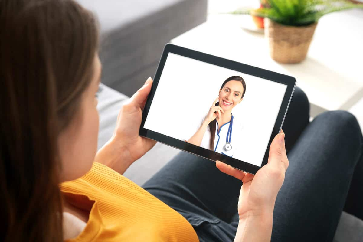 Practitioner conducting a virtual appointment