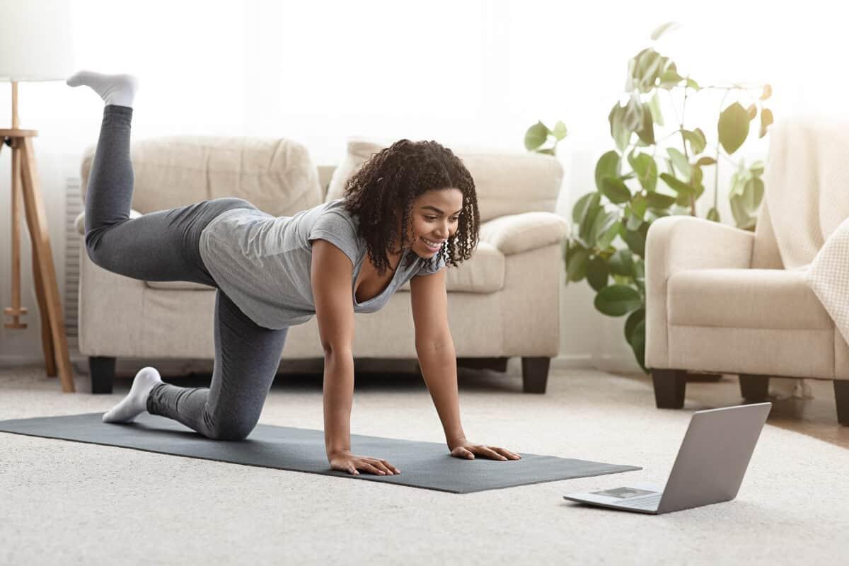 Woman doing virtual yoga
