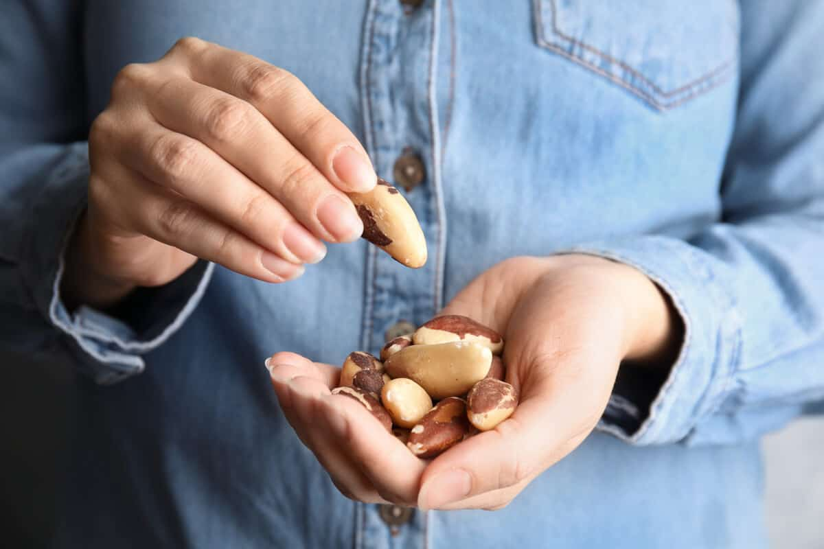 Person holding a handful of nuts