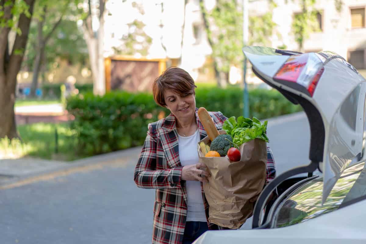 Woman loading groceries into her car
