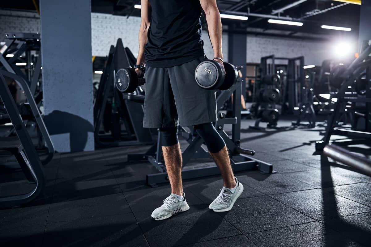 Man lifting dumbbells at a gym