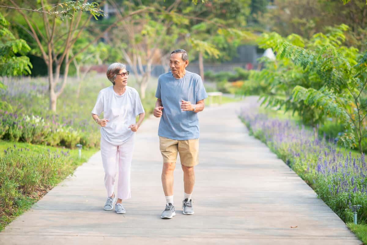 two elderly people going for a walk