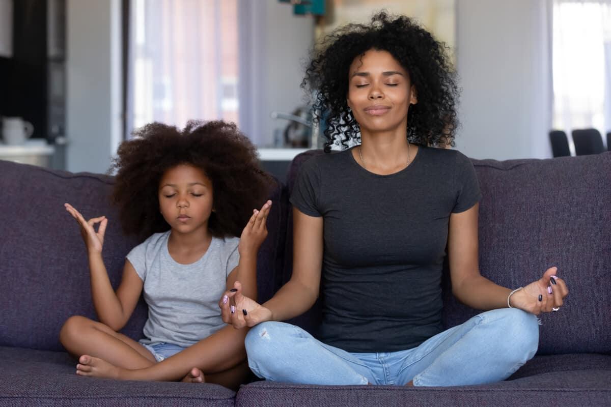 Woman and child meditating