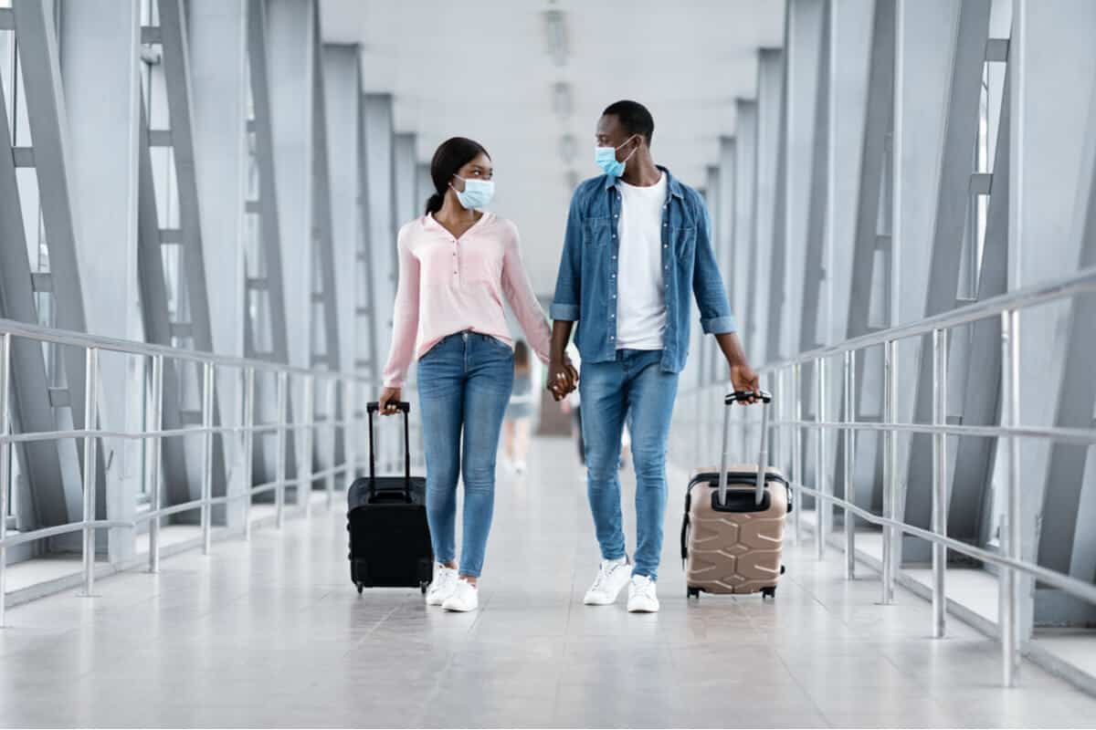 A man and a woman walking in an airport