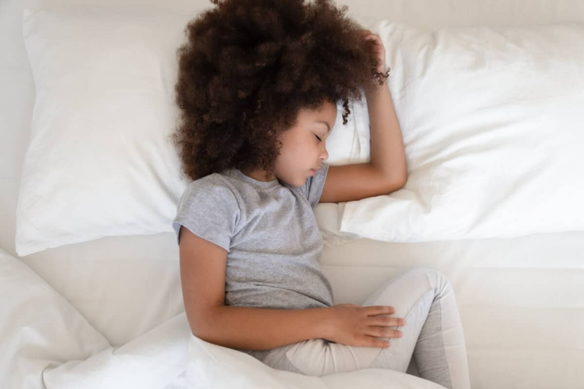 Child lying in bed sleeping