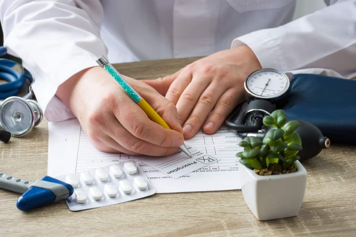 Practitioner writing a prescription