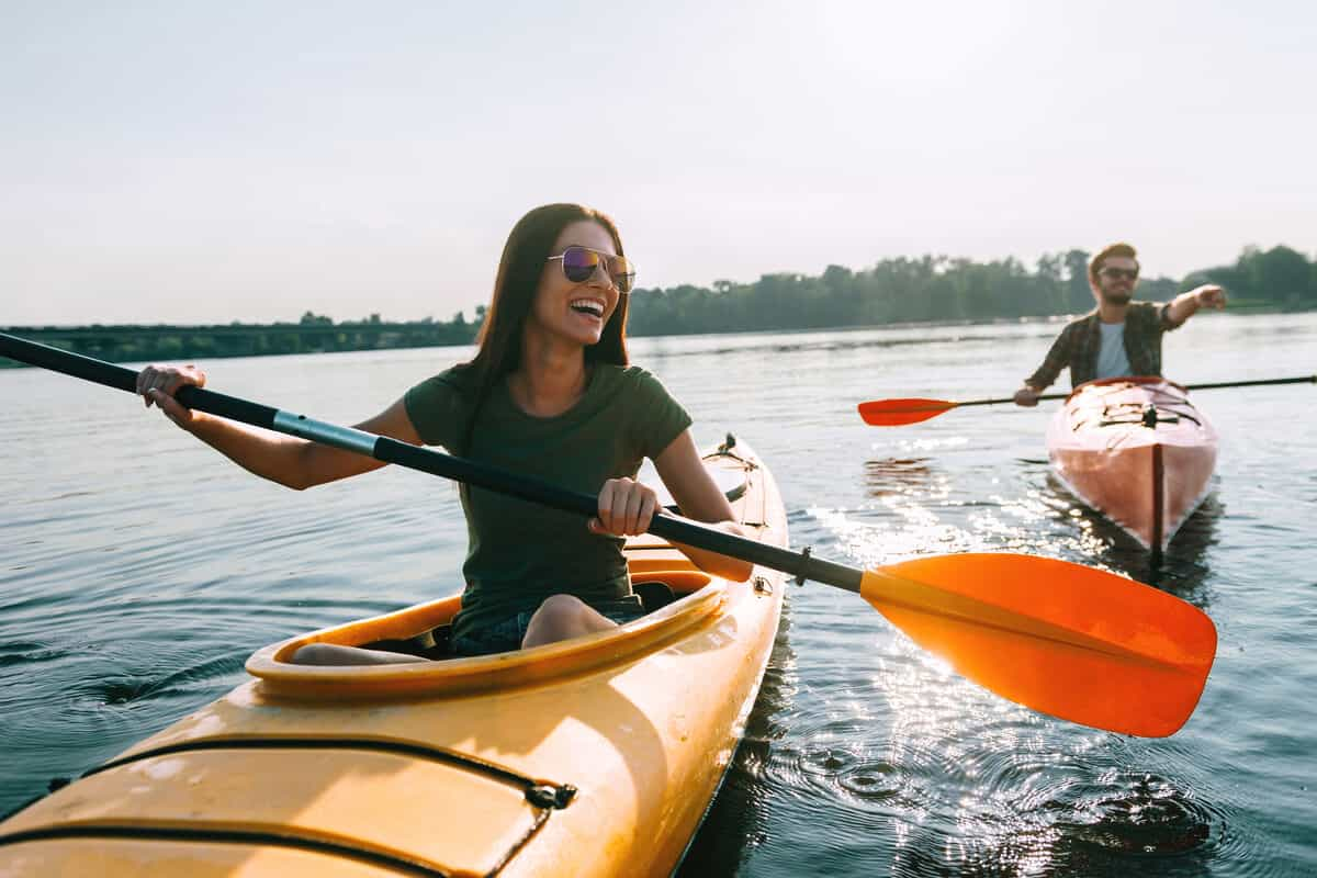 A man and a woman kayaking in a lake