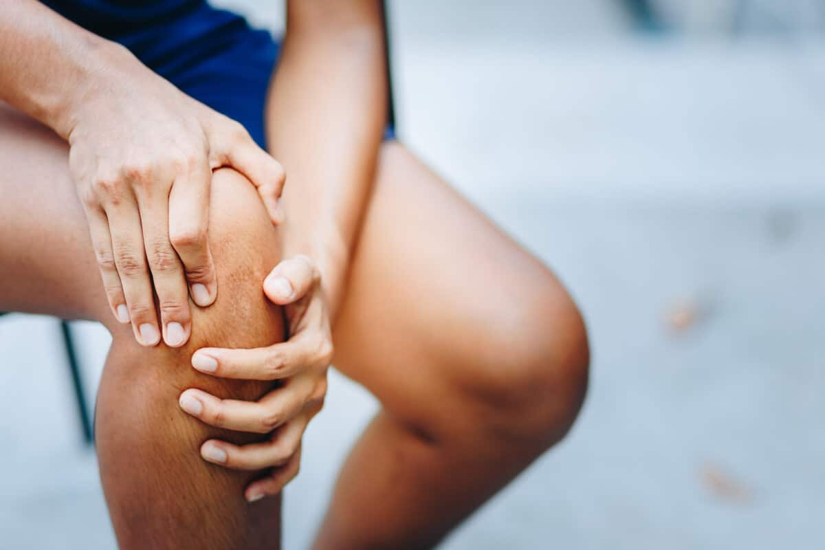 Person holding their knee
