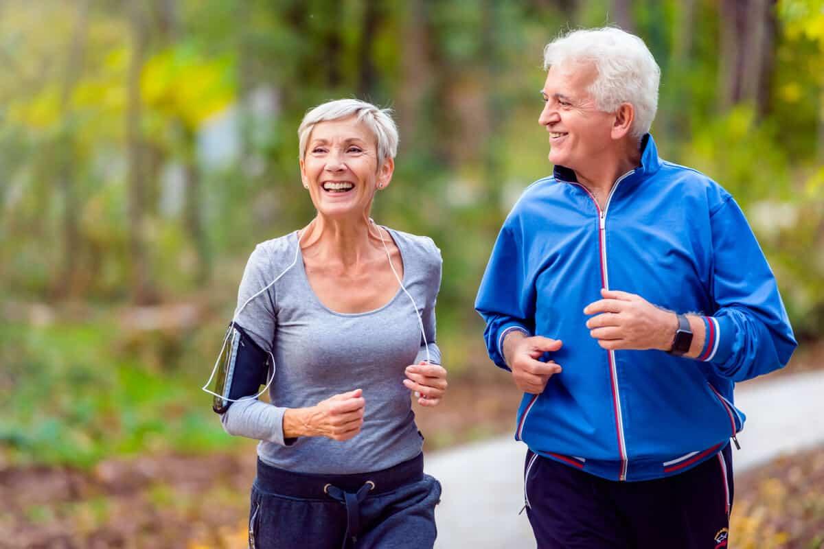 Two elderly people running