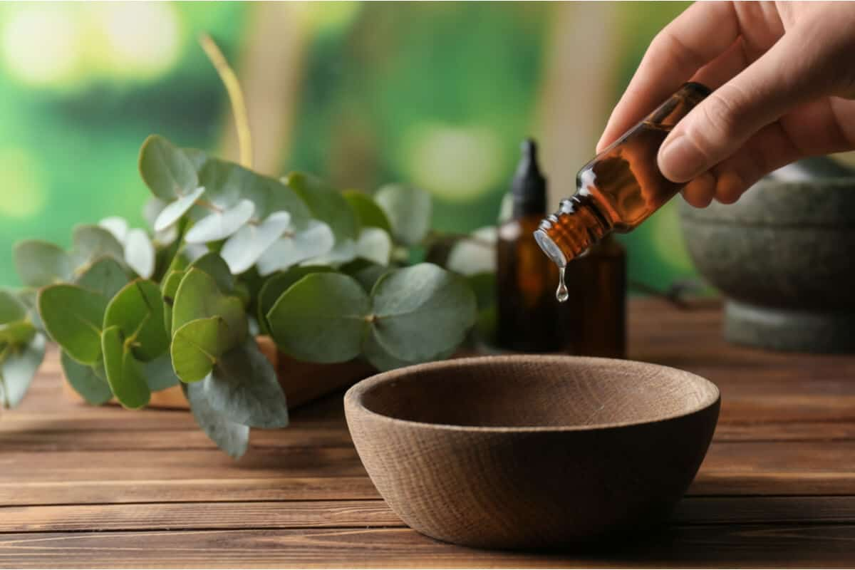 Essential oil being poured into a bowl