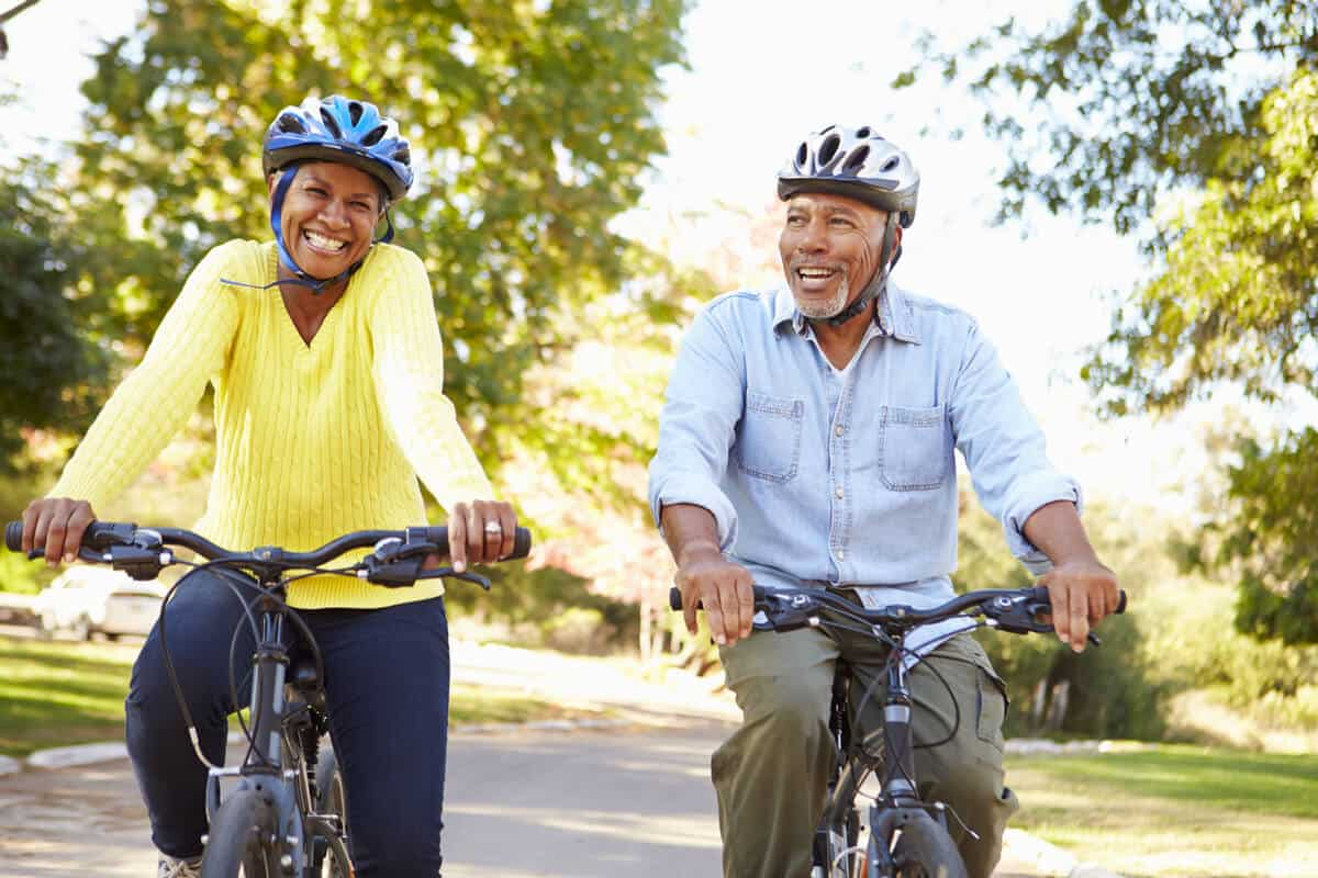Two adults riding bicycles