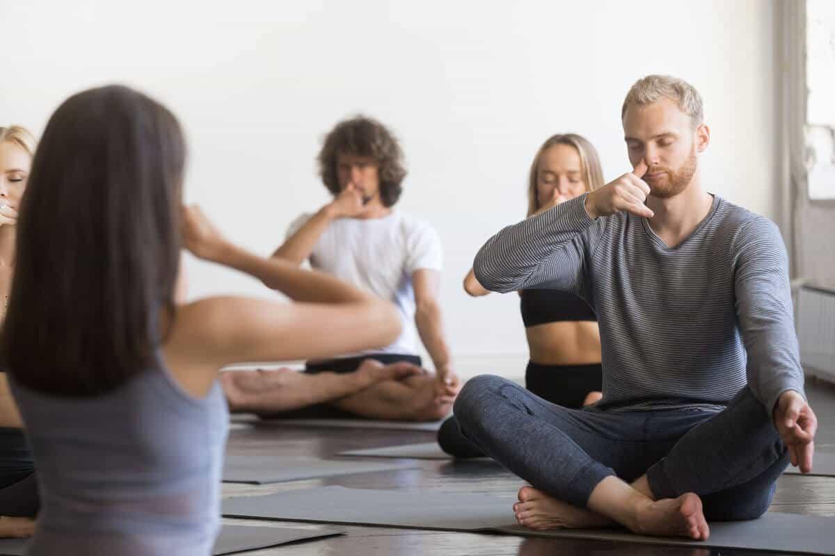 Breathing exercises people doing yoga